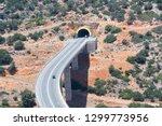 he highway exits the mountain... | Shutterstock . vector #1299773956