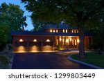 red brick house with circular... | Shutterstock . vector #1299803449