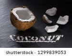 half of ripe coconut and its... | Shutterstock . vector #1299839053