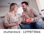 man giving a gift to his... | Shutterstock . vector #1299875866