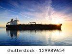 Cargo Ship Sailing Away Agains...