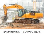 the excavator excavation at the ... | Shutterstock . vector #1299924076