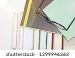 glasses and books  knowledge is ...   Shutterstock . vector #1299946363