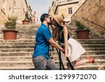 man and woman walking and... | Shutterstock . vector #1299972070