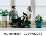 happy couple at home with dog | Shutterstock . vector #1299983236