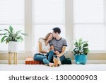 happy young couple at home  | Shutterstock . vector #1300000903