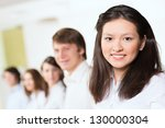young businessmen standing in a ... | Shutterstock . vector #130000304