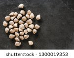 raw clams on slate stone... | Shutterstock . vector #1300019353
