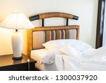 rumple pillow on bed decoration ... | Shutterstock . vector #1300037920