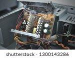 disassembled burnt power supply ... | Shutterstock . vector #1300143286