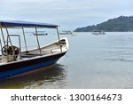 tourist boat moored by the sea... | Shutterstock . vector #1300164673