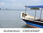 tourist boat moored by the sea... | Shutterstock . vector #1300165669