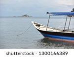tourist boat moored by the sea... | Shutterstock . vector #1300166389
