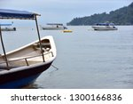 tourist boat moored by the sea... | Shutterstock . vector #1300166836