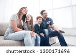 happy family watching their... | Shutterstock . vector #1300171696