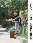 family with suitcases voting on ... | Shutterstock . vector #1300177996