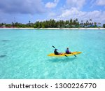 happy couple kayaking in the... | Shutterstock . vector #1300226770