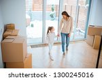 happy mother holding hands with ... | Shutterstock . vector #1300245016
