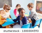 group of kids while painting... | Shutterstock . vector #1300304593