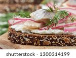Stock photo delicatessen open sandwich smorrebrod with herring red onions cream cheese ricotta and dill on 1300314199