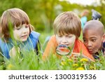 children lying in the grass and ... | Shutterstock . vector #1300319536