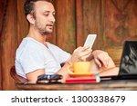 man with smartphone  coffee  ... | Shutterstock . vector #1300338679