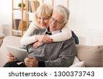 senior couple using digital... | Shutterstock . vector #1300373743