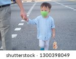 father and son holding hand... | Shutterstock . vector #1300398049