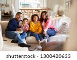 young grandparents sitting with ... | Shutterstock . vector #1300420633