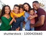 mixed race three generation... | Shutterstock . vector #1300420660