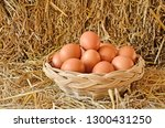 woven rattan basket of eggs on... | Shutterstock . vector #1300431250