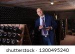 winemaker controlling... | Shutterstock . vector #1300495240