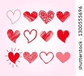red hand drawn hearts set.... | Shutterstock .eps vector #1300555696