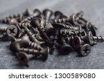 screws on a dark background... | Shutterstock . vector #1300589080