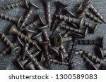 screws on a dark background... | Shutterstock . vector #1300589083