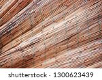 crinkled bamboo fence texture... | Shutterstock . vector #1300623439