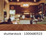 empty wooden table blurred of... | Shutterstock . vector #1300680523