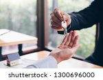 real estate agent holding house ... | Shutterstock . vector #1300696000