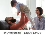 shot of pretty young parents... | Shutterstock . vector #1300712479