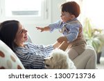 shot of pretty young mother... | Shutterstock . vector #1300713736
