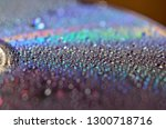The Cd Is Covered With Drops O...