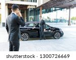 protection officer opening car... | Shutterstock . vector #1300726669