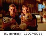 dogs bring them joy. muscular... | Shutterstock . vector #1300740796