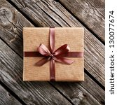 vintage gift box on old wooden... | Shutterstock . vector #130077674