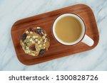 fresh hot coffee and pecan oat... | Shutterstock . vector #1300828726