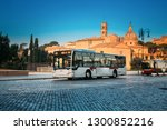 rome  italy. public bus driving ... | Shutterstock . vector #1300852216