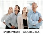 young business team looking at... | Shutterstock . vector #1300862566
