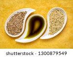 dry hemp seeds  hearts and oil... | Shutterstock . vector #1300879549