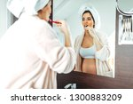 pregnant young woman brushing...   Shutterstock . vector #1300883209