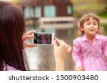 happy mother with a child take...   Shutterstock . vector #1300903480